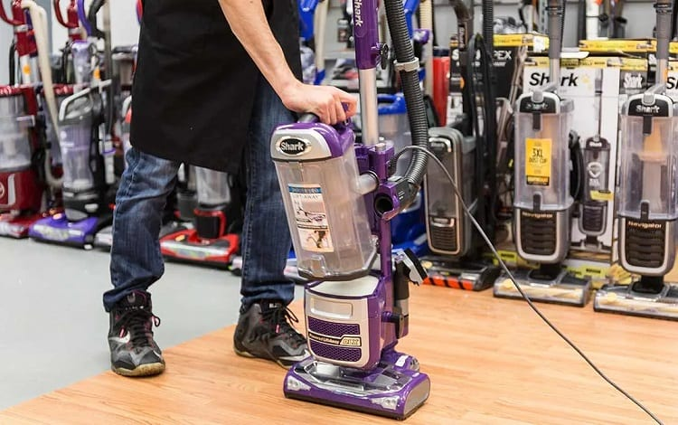 seller with vacuum cleaner